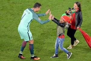 Uncle Ronaldo!: Mother and child meet their hero. Photo credit: https://mobile.facebook.com/uefaeuro?_rdr