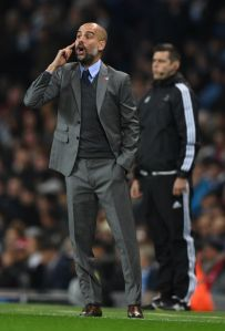 Are You Seeing What I'm Seeing?: Pep Guardiola passes instructions to his boys from the touchline during Manchester City's 3-1 win over Barcelona. (Photo credits: Mirror.co.uk)