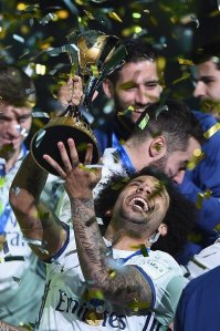 Glorious Year: Marcelo rejoices as he hoists the FIFA Club World Cup in Japan