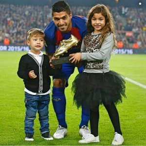 Highest Goal-scoring Father: Luis Suarez poses with the European Golden boot alongside his kids
