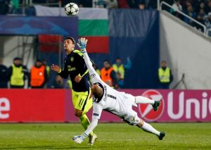 Picture Perfect, Award Worthy: Mesut Ozil finds his way past Ludogorets goalkeeper in a UEFA Champions League match during the year.